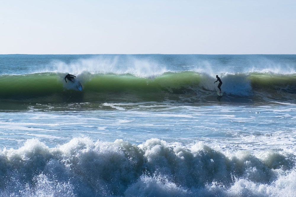 dropping in on surfer